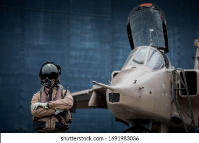 Royal Air force (RAF) Jaguar strike attack fighter jet with pilots wearing flying suits and helmets ready to fly their aeroplanes.