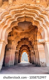 Royal arches of 14th century architecture of Lotus Mahal temple at Hampi, India. This historical monument is a UNESCO world heritage site.