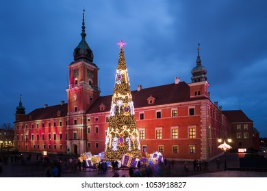 Royal Castle and Christmas tree illuminated in the evening in city of Warsaw, Poland