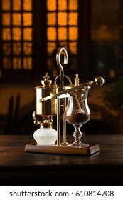 Royal coffee in siphon. The golden royal siphon. Making coffee. Freshly brewed coffee.