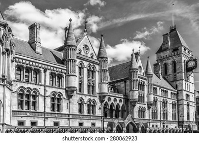 Royal Courts of Justice in the Victorian Gothic style (Law Courts, designed by George Edmund Street, was opened by Queen Victoria in December 1882) in London, UK. Black and white.