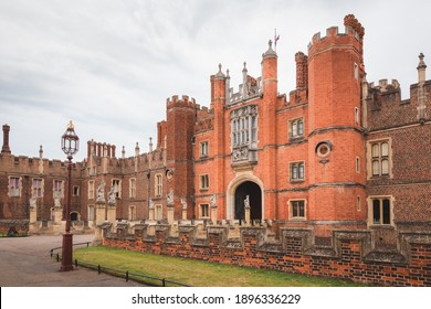 The royal courtyard entrance to the 16th century Hampton Court Palace, residence of Henry VIII at Richmond Upon Thames, in London, England.