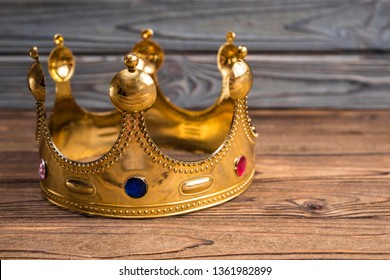 Royal crown of the Emperor on a wooden background. headdress of the reigning person.