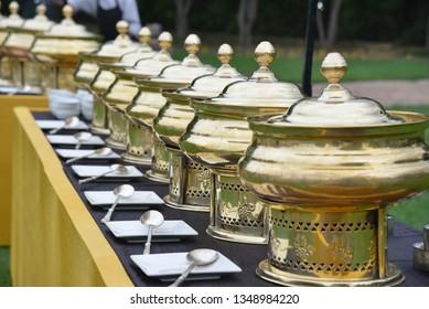 Royal dining setup destination wedding buffet food, spoon and plates - Image