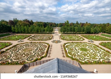 Royal Dutch palace garden with a view from the roof of the palace. Composite me perspective and sunny view over landscaped garden and fountains