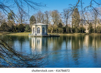 Royal field of Compiegne. FRANCE - April 5th, 2016. Park and lake of the Royal Field of Compiegne with sight on the Castle and the view-point. Remain of Louis XV
