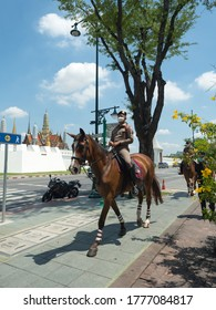 The Royal Field (Sanam Luang), Bangkok, Thailand - JUL 7 , 2020 : Royal Thai mounted polices on a horse in front of the Grand Palace.