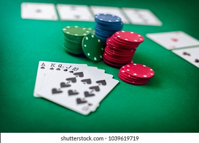 Royal flash with chip cards on the table. Poker game. Poker playing set.