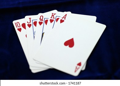 A Royal Flush (10, J, Q, K, A) in the Hearts suit against a dark blue background