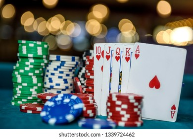 Royal flush combination with poker chips in casino