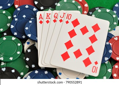 A royal flush displayed with poker chips