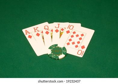 Royal flush on the green casino table