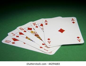 Royal Flush on a green poker table