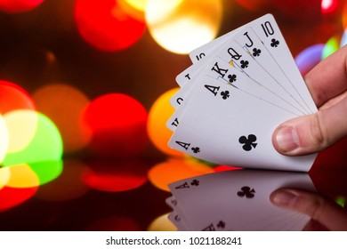 Royal flush poker cards combination on blurred background casino luck fortune card game