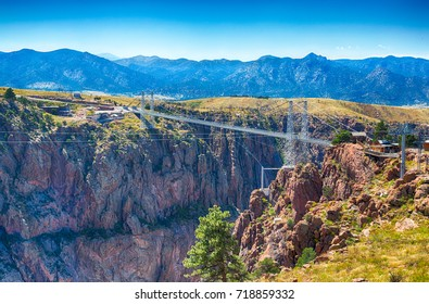 Royal gorge canyon and the associate suspension bridge draw tourists to Colorado.