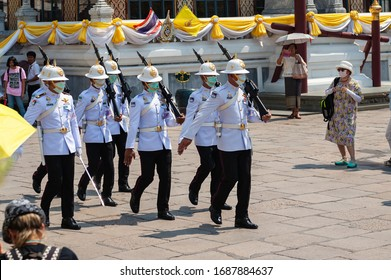 The Royal Grand Palace, Bangkok, THAILAND – February 2020: Thai Royal guards wearing face protection masks in prevention for coronavirus.