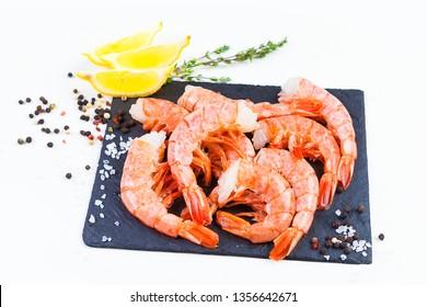 royal headless shrimp on black board isolated on white background