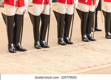 Royal horse guards at the Admiralty House in England. Part of body, solider boots