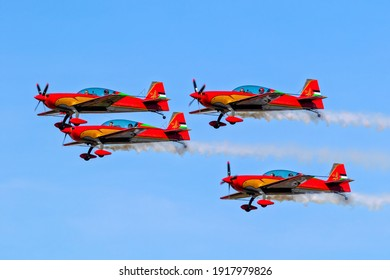 Royal Jordanian Falcons aerobatic team in their Walter Extra EA330LX planes in formation over Kleine-Brogel Airbase. Belgium - September 14, 2019.