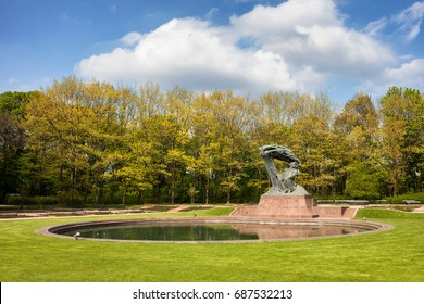 Royal Lazienki Park in spring and Fryderyk Chopin Monument in Warsaw, Poland, city landmark
