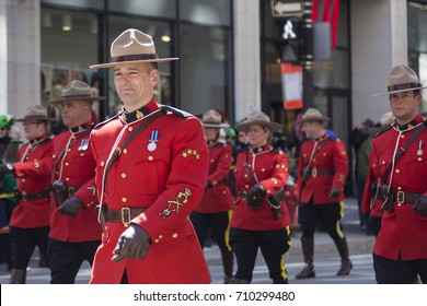Royal Mounted Police on foot at Montreal Saint Patrick's Day Parade on Saint Catherine Street, Montreal, Quebec, Canada, March 20, 2016