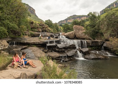 ROYAL NATAL NATIONAL PARK, SOUTH AFRICA - MARCH 14, 2018: Unidentified tourists relaxing at the Cascades in the Mahai River in the Royal Natal National Park in Kwazulu-Natal