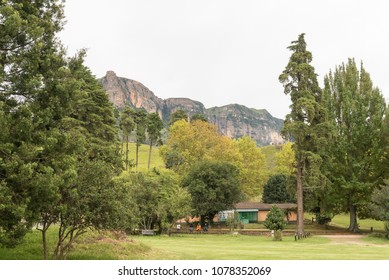 ROYAL NATAL NATIONAL PARK, SOUTH AFRICA - MARCH 14, 2018: Park employees at the Mahai camp site in the Royal Natal National Park in Kwazulu-Natal. A building, mountain and trees are visible