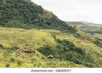 ROYAL NATAL NATIONAL PARK, SOUTH AFRICA - MARCH 17, 2018: Unidentified hikers on Lookout Rock near Mahai in the foothills of the Kwazulu-Natal Drakensberg