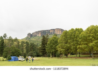 ROYAL NATAL NATIONAL PARK, SOUTH AFRICA - MARCH 14, 2018: The Mahai camp site in the Royal Natal National Park in Kwazulu-Natal. A tent, vehicles and people are visible