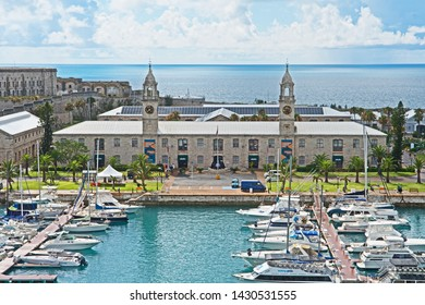 Royal Naval Dockyard, Bermuda - June 18 2019: the exterior of the Clocktower Mall with a marina in front. Built by the British Royal Navy as a warehouse in the 1850s it is now home to a range of chops