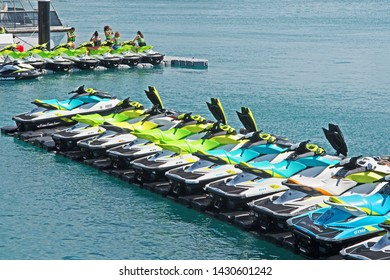 Royal Naval Dockyard, Bermuda - June 16 2019: rows of brightly colored jet skis are available for rent.