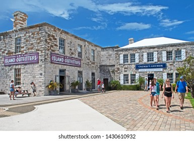 Royal Naval Dockyard, Bermuda - June 16 2019: shops and pubs now occupy some of the historic stone building at the Royal Naval Dockyard in Bermuda.