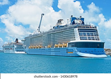 Royal Naval Dockyard, Bermuda - June 18 2019: the cruise ship Anthem of the Seas is moored at Heritage Wharf with the cruise ship Norwegian Gem moored at Kings Wharf in front of her.