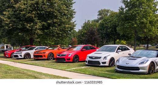 ROYAL OAK, MI/USA - AUGUST 16, 2018: Six sporty General Motors cars at the Woodward Dream Cruise: Cadillac ATS (2),Chevrolet Camaro (2), Chevrolet Corvette, Buick Regal GS
