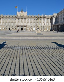 Royal Palace of Madrid exterior view with railings shadow
