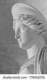 Royal Palace of Naples, Italy, september 2017.  Detail of a white marble statue representing a classical and elegant woman.
