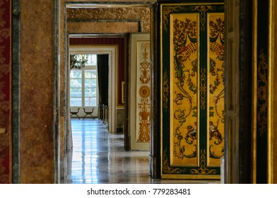 Royal Palace of Naples, Italy, september 2016. The repetition of the doors of the many rooms of this extremely wealthy place view from a central perspective