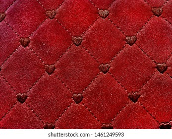 Royal pattern with diamonds and hearts. Burgundy background. Leather upholstery. Ornament for bag design, wallet, upholstered furniture.