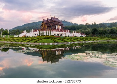 Royal Pavilion, its reflection in pond and cloudy pinkish sky in the morning at Royal Flora Ratchaphruek  park. Chiang Mai, Thailand