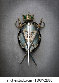 royal shield, sword and crown on gray background