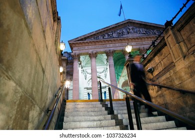 The Royal Stock Exchange, London, at Night. Stairs and motion blurred moving person present.