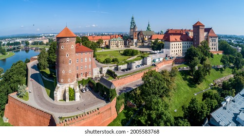 Royal Wawel Castle and Gothic Cathedral in Cracow, Poland, with Renaissance Sigismund Chapel with golden dome,  Sandomierska and Senatorska towers, walls, yard, park and tourists. Aerial view