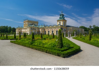 The royal Wilanow Palace in Warsaw, Poland, with gardens, statues and river around it, on June 12, 2018.