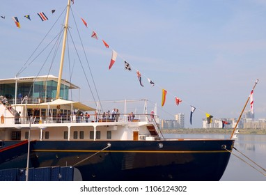The Royal Yacht Britannia, former ship of the British Royal Family, now a tourist attraction in the Port of Leith, Ocean Terminal, Edinburgh, Scotland UK. June 2018