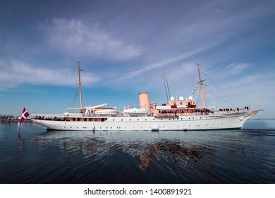 The Royal Yacht Dannebrog reflecting on sea Assens