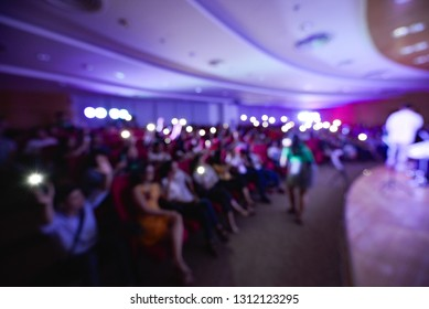 Royalty high quality free stock photo of abstract blur and defocused of audience in a conference room. They are attending a seminar or talkshow. Photo taken with wide viewing angle
