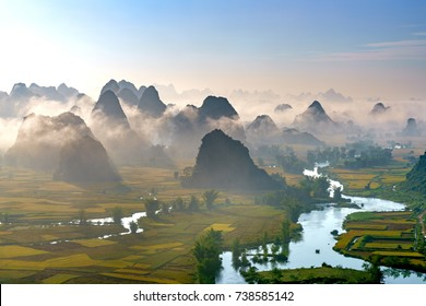Royalty high quality free stock image of dawn and fog, mountains, river  and rice field at Trung Khanh town, Cao Bang province, Vietnam.