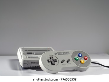 Royston, UK - 18 January 2018: A Super Nintendo classic mini gaming console with one joypad (Illustrative editorial)
