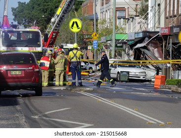 ROZELLE, AUSTRALIA - SEPTEMBER 4, 2014;   Firefighters and rescue crew discuss an action plan for a search and rescue mission after explosion at store. Police are treating the explosion as suspicious