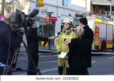 ROZELLE, AUSTRALIA - SEPTEMBER 4, 2014; Today Show Chris Urquhart and ABC news reporter are briefed by Superintendent Paul Johnstone of Fire and Rescue regarding the tragic explosion and fire.